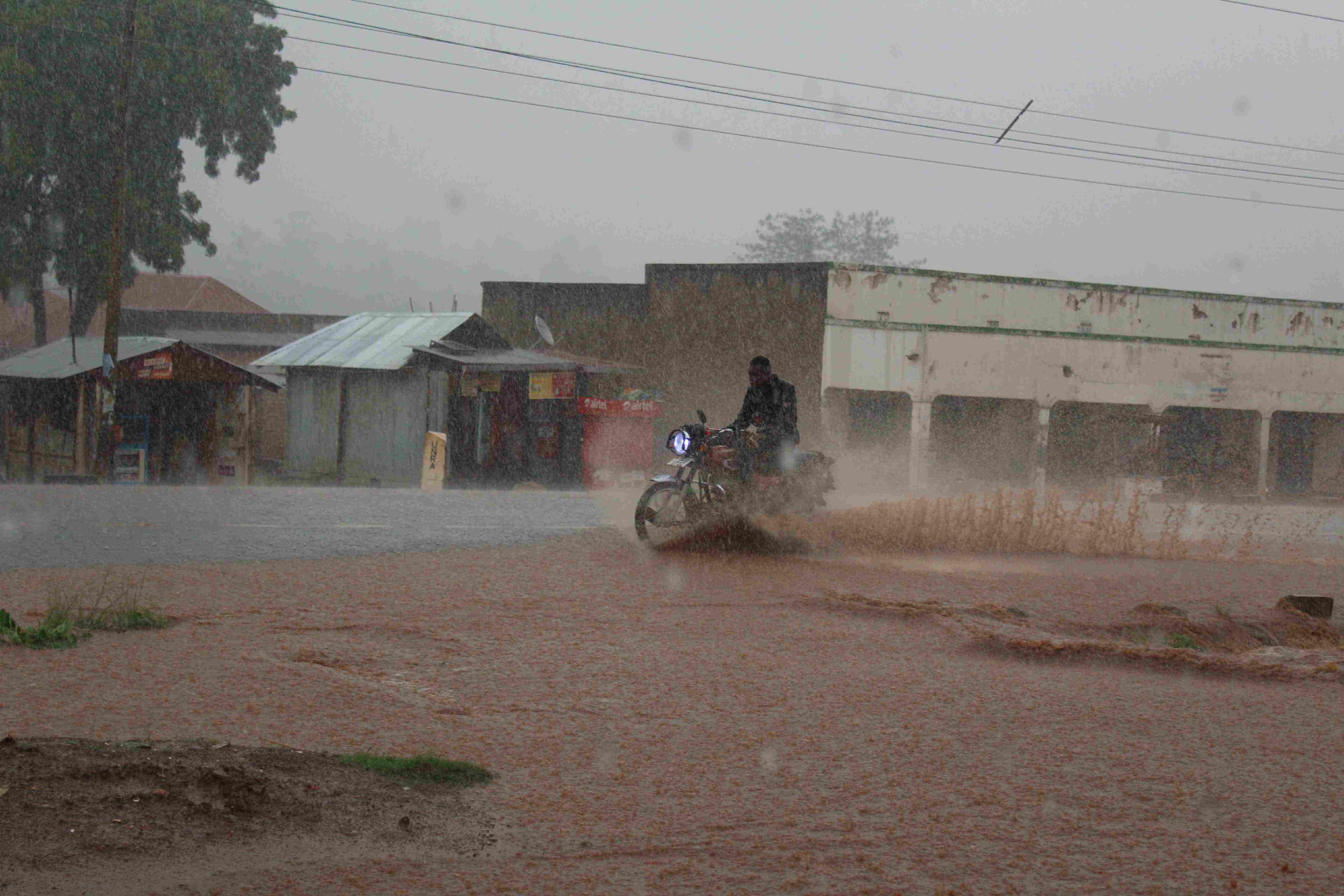 Boda Motor Cyclists Dared the Rain